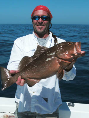 Capt. Dan Barry of The Jawbreaker holding a nice grouper.