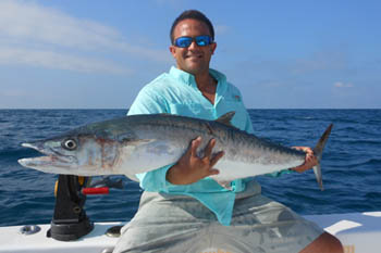 Young kid caught Kingfish during St. Petersburg, FL fishing charter.