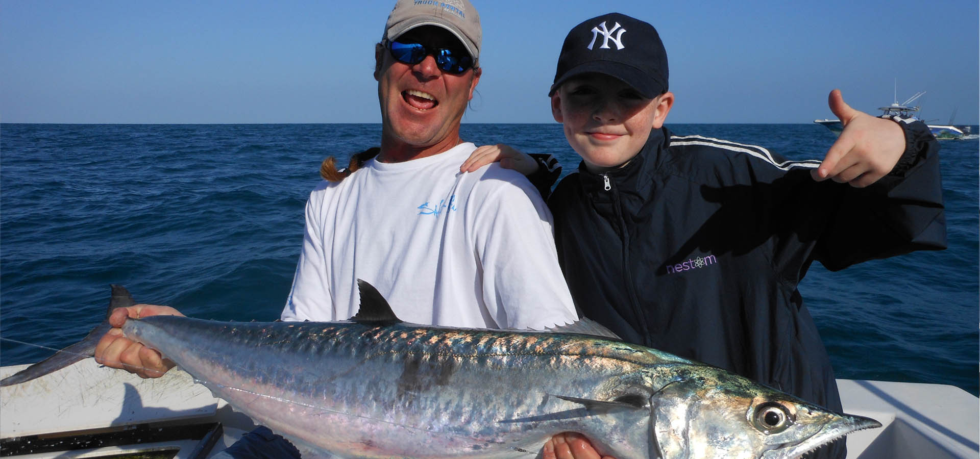 Capt. Dan Barry and young boy with Kingfish.